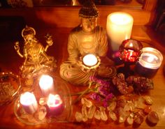 Windowsill meditation altar aglow with candles, crystals and more.