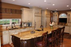 Tan and brown mottled granite countertops. #kitchen