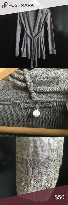 Grey belted cardigan sweater Knitted and knotted belted grey cardigan sweater by Anthropologie. Size small. Delicate design see photo, no material content tag but it is wool poly blend. Great condition Anthropologie Sweaters Crew & Scoop Necks