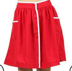 """❤ Vintage inspired skirt! NWOT ❤When in doubt wear RED❤  Adorable cherry red vintage inspired skirt! Don't forget to add this to your summer spring wardrobe! White trim adds detail to this skirt! Pockets on front make it easy to hold your cellphone or money.  Button down front  Brand new no tags MATERIAL: 55% linen 45% rayon,white trim 100% rayon  Length approx 20.5"""" Size small    ❤PRICE IS FIRM unless bundled  ❤NO TRADES Skirts"""