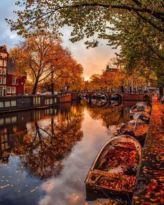 A boat sits quietly in an autumn stream in The Netherlands