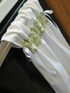 Kitchen towels that don't end up on the floor.  They stay put.  You'll need: A two-pack of kitchen towels,two yards of ribbon per towel, and two strips of fabric about 3 inches tall & the width of the towel.  Full tutorial is here: http://pin-sew-press.blogspot.com/2010/05/tutorial-stay-put-kitchen-towel.html