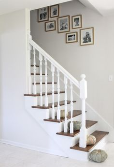 Add pumpkins to stairs to create an inviting fall entry