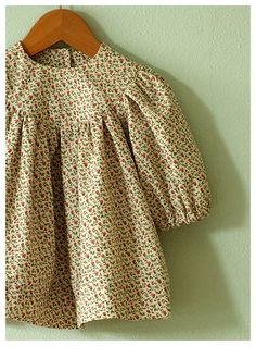 PATTERN: McCall's 5257 (out of print) VIEW: A (modified) SIZE: Newborn FABRIC: Unidentified calico, from Mill End Store