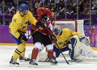 Canada forward Jonathan Toews scores past Sweden goaltender Henrik Lundqvist as Patrik Berglund looks on during first period men's gold medal final hockey action at the Sochi Winter Olympics Sunday, February 23, 2014 in Sochi. THE CANADIAN PRESS/Paul Chiasson