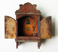 Shrine by Donna Flax.  Beautiful little wall hanging, like a little portal you can open and enter into.