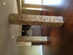 Columns in basement - add stone. They look fabulous.