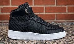This new colorway of the Nike Air Force 1 High features a woven upper in all-black with white accents.