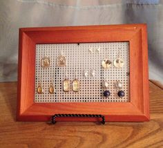 Earring Holder - End earring clutter!!  No more searching through heaps of earrings and earring backs.  Simply remove the glass and backing from a picture frame and replace with plastic canvas.  Set it on a small plate stand to hold it up, and your favorite earrings are available at your fingertips.