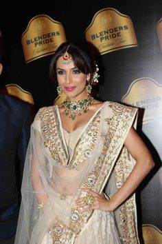 Malaika Arora in a gorgeous cream and gold Indian bridal lengha on IndianWeddingSite.com