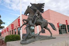 """The Rebels"""" statue by artist Jerry Anderson. The statue depicts a Confederate soldier on horseback helping an injured comrade, with a Confederate flag in hand. (Dixie State University returning controversial 'Rebels' statue to artist) 