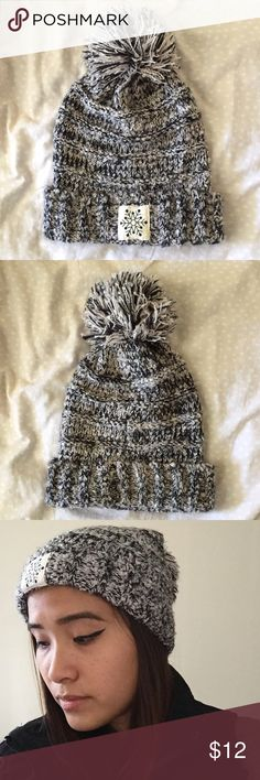 Grey Snowflake Beanie Warm and fluffy grey beanie. Gently used. Open to offers!! Accessories Hats