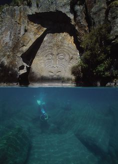 Maori carvings at Mine Bay on Lake Taupo, New Zealand   Gonna need to get certified for this one