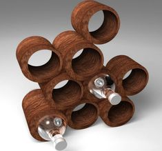 Hand-crafted wine rack fits into the one-off concept of post-industrialism. The cork/wood material is quite raw. Need to think about circle shapes.