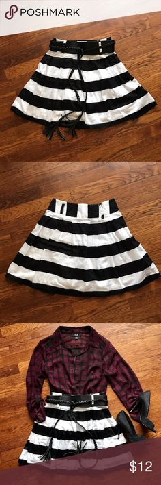 Black & White Striped Skirt Fully lined, cute black and white striped mini skirt. Has side zipper for easy wear.  • No Trading  • Reasonable Offers are Always Welcomed Forever 21 Skirts Mini