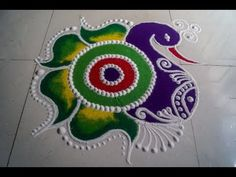 Hi Friends, In this video, we are going to see how we can make a peacock rangoli design with sanskar rangoli symbols along with rangoli color mixing/shading. Easy Rangoli Designs Videos, Rangoli Designs Simple Diwali, Simple Rangoli Border Designs, Rangoli Simple, Rangoli Designs Latest, Free Hand Rangoli Design, Small Rangoli Design, Rangoli Designs With Dots, Beautiful Rangoli Designs