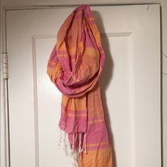 J. Crew summer scarf Lightweight, almost sheer, cotton sorbet colored striped scarf with white fringe. J. Crew factory summer 2015.  Beautiful airy cotton softens with use! Could also be used as a wrap! J. Crew Accessories Scarves & Wraps