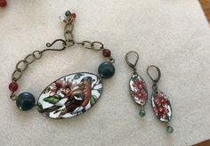 Custom order: Vintage tin bracelet and earring set. Birds and flowers Daher tin from the 1970's, deep green agate, and carnelian. By Leigh Davenport of Entwyne Designs. EnywyneDesigns.etsy.com