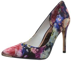 This pointed toe Ted Baker pump features the focus bouquet satin print metal bow stud at the back counter and metal toe tip....