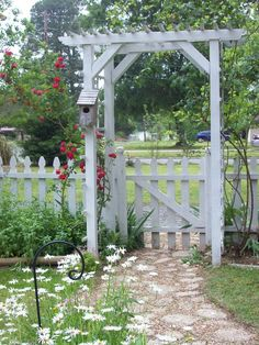 TX - White picket fences and rose arbors. I drew out the design for my cottage garden, researching plants that would do well in our area. The sidewalk is a mixture of concrete cobblestones and pea gravel.  ~ Great pin! For Oahu architectural design visit http://ownerbuiltdesign.com