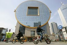 A building in the shape of a giant traditional Chinese coin in northeastern China was chosen as one of the world's ugliest buildings last year.