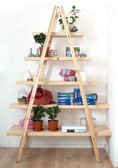 DIY ladder bookshelf and bookcase ideas that you can make using old ladders and a little creativity. Make your diy ladder shelf bookcase today!