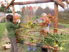 garden loom - this was a huge success!  we added moss, bits of wool roving, sticks, cherry bark, flowers and grasses
