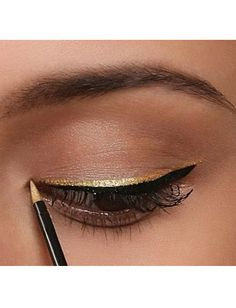 Likin' this simple gold over black liner look