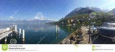 Photo about Ferry Dock in France looking toward Switzerland in the Alps along the shore on Lake Geneva. Image of mountains, swiss, europe - 61306973 Geneva France, Lake Dock, Lake Geneva, Alps, Switzerland, Europe, Stock Photos, Mountains, Image