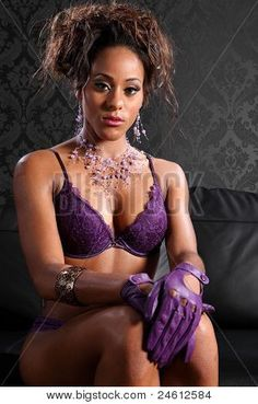 Stunning young african american glamour model woman wearing sexy purple lace lingerie and leather gloves sitting on black leather sofa. Description from bigstockphoto.com. I searched for this on bing.com/images