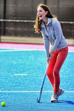 Kate Middleton wore a pair of bright red skinny jeans with a gray sweatshirt and sneakers to play field hockey at the Riverside Arena in the Olympic Park in London.