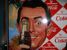 Coca-Cola advert    Imagery: One Eye symbolism...strange placement. Not an accident.