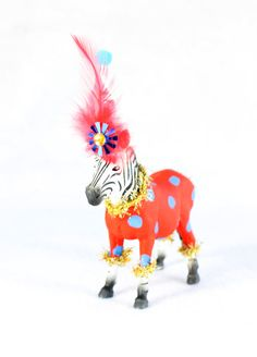 Bart, is a real party animal! Bring some fun to your next party or event with these whimsical animals.Each is hand painted, and adorned with fun