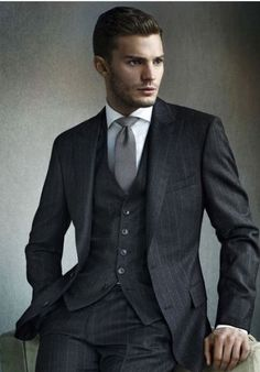 Check out this amazing 3 piece suit the light grey tie compliments the dark grey waist coat and suit jacket. Suit heaven #hugo boss