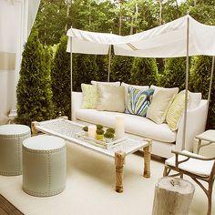 Elsa Soyars - decks/patios - sofa canopy, outdoor sofa, , Trina Turk Peacock Print Fabric, Currey & Co. Woodland Armchair, Lee Industries Drum Ottoman,