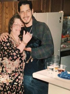 Chris Cornell with his mom and a pupper