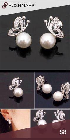 Butterfly Earrings Cute silver toned butterfly earrings with faux pearls. New in package. Jewelry Earrings