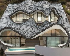 Zinc shingles cover a cliffside roof designed by GilBartolomé Architects