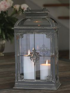 This is a really beautiful lantern. It has a French vintage look to it. It has a unique top, with its curved glass. A real must have for these crips Autumn days.Measurements approx:Height 40cm**candles not included