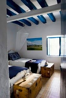 blue beams on white ceiling, white walls