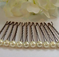 DIY pearl bobby pins. this could be done with any bead or bit of bling. pretty and easy-peasy.