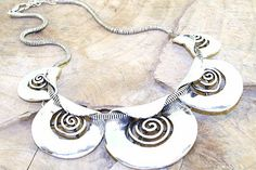Heavy metal folded disc necklace.