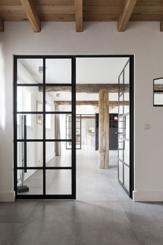 doors and windows that feel timeless but modern - love the contrast with the dark panes