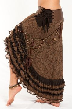 surprisingly beautiful gypsy brown skirt with tied lacing at the hip and ruffles around the hem