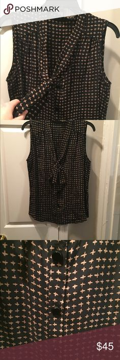Rebecca Minkoff tie front top Rebecca Minkoff tie front top in black with tan crosses. Button down the front. Perfect condition. Only worn a few times. Dry clean. Silk. Rebecca Minkoff Tops Blouses