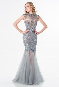 Shimmering evening gown for special occasions, cap sleeves with glittering stones, sweetheart shape, shimmering beads, fitted bodice, tulle skirt, full length hem. Fabric Content : 100% POLYESTER