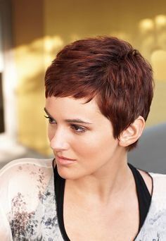 This charming and alluring pixie cut has those medium-thick strands of cherry red hair. The short bangs are really lovely and attractive while the top section is littered with cool short layers to augment the volume and texture of this hair. The sides and back, likewise, have short layers which are really cool and attractive. I would really love to sport this hairstyle during summer. - See more at: http://www.short-haircut.com/pixie-cuts-for-women.html#sthash.Vd9zmUl3.dpuf