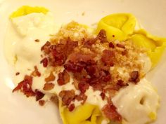 tortellini al forno cheese and prosciutto filled tortellini in a Parmesan  cream sauce topped with bacon from Olive Garden