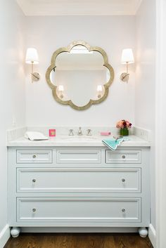 Cute idea for girls bathroom. Mint vanity with marble top and gold mirror/sconces
