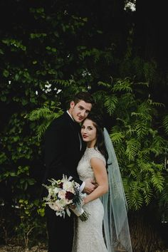 Romantic shot of this couple against lush greenery. | Image by Kym Ventola